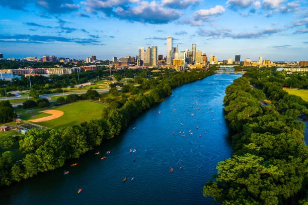 Lady Bird Lake Kayakers above Austin , Texas , USA Summer Fun on the Lake Aerial Drone view above Lady Bird Lake Kayakers above Austin , Texas , USA Summer Fun on the Lake  2019 colorado river stock pictures, royalty-free photos & images