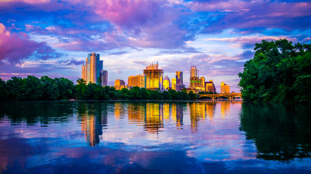 Lady bird lake purple reflections of a golden city stock photo