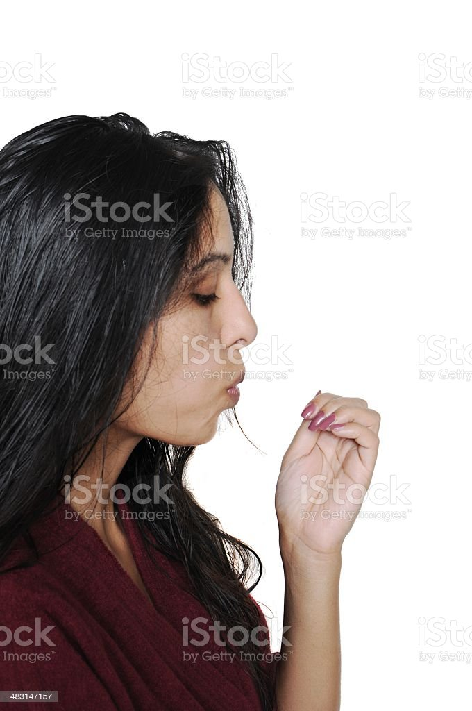 Lady blowing her painted nails to dry. stock photo