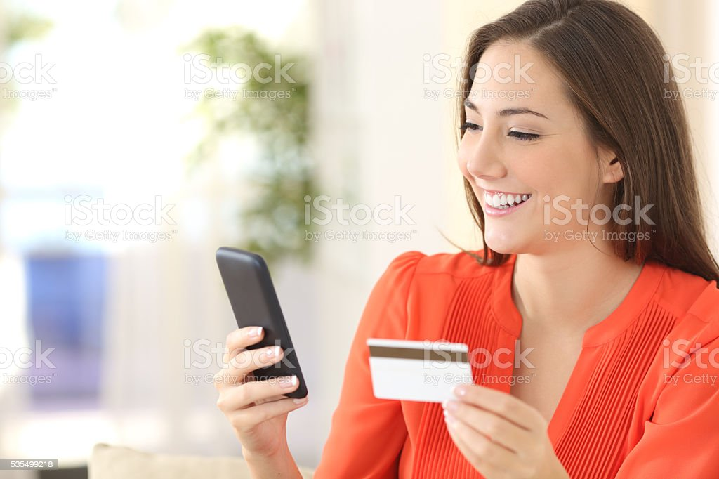 Lady buying with credit card and smart phone stock photo