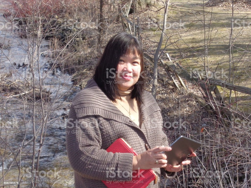 Lady by Drainage Ditch stock photo