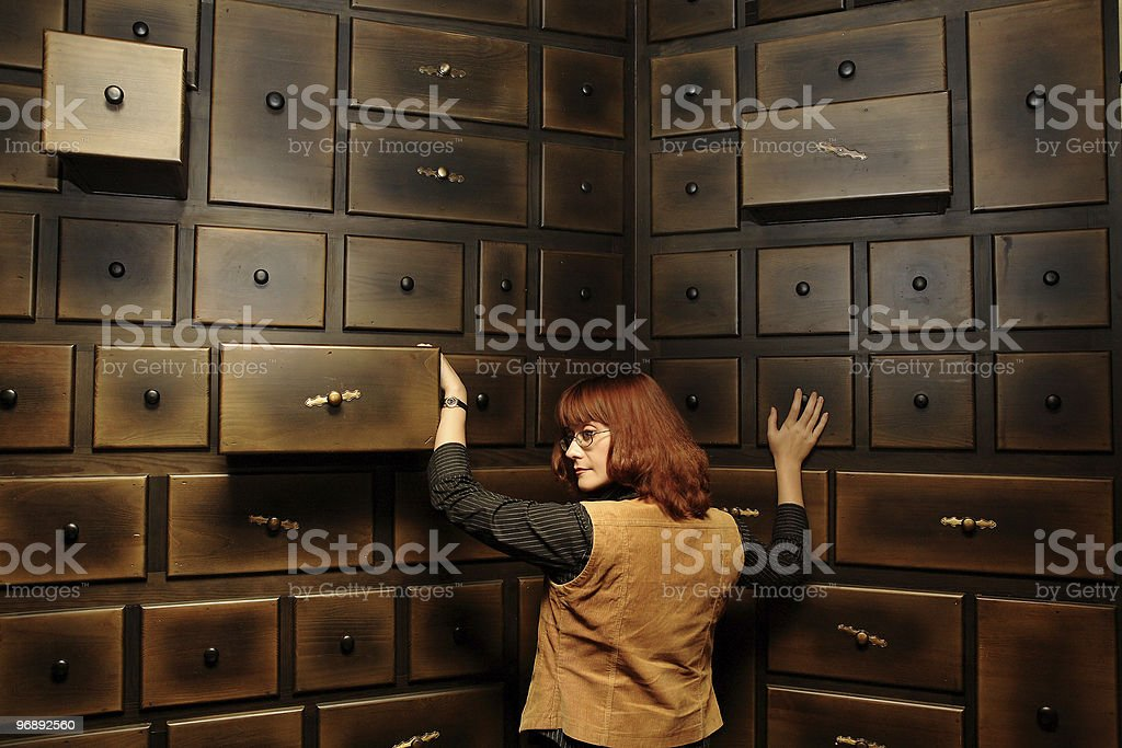 Lady by the antique cabinet royalty-free stock photo