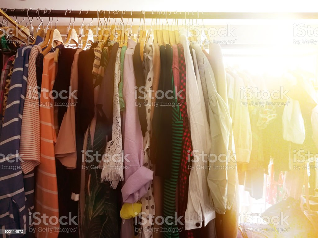 lady clothes hanging in shop brand name stock photo