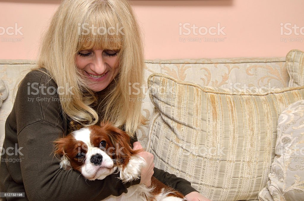 Lady Cuddling Dog stock photo