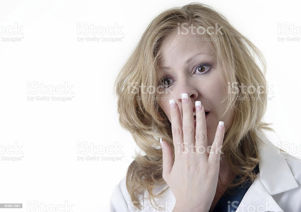 Lady doc with hand covering mouth royalty-free stock photo