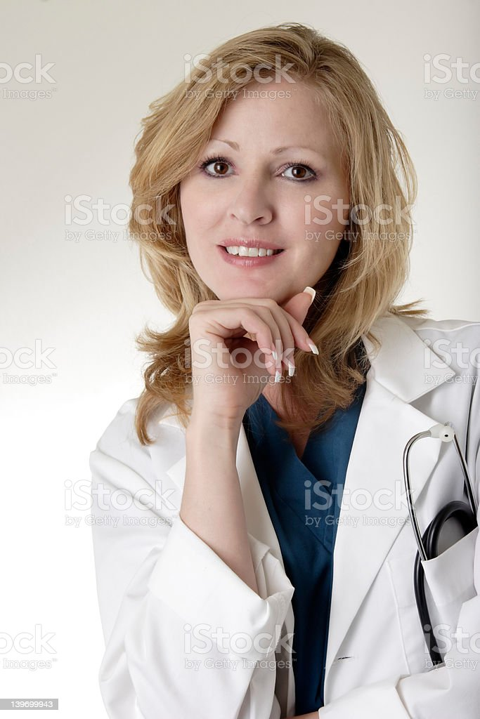 Lady doctor with hand on chin royalty-free stock photo