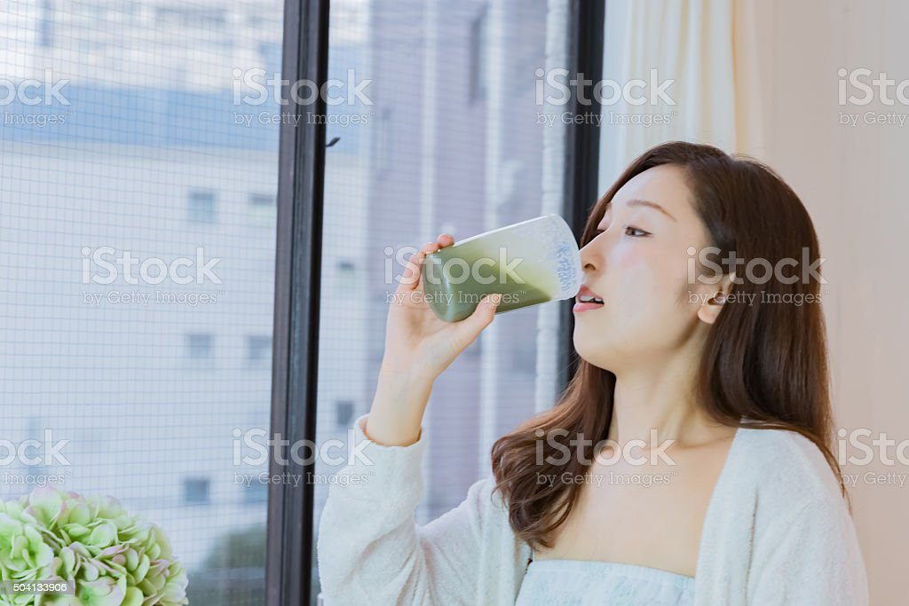 Lady drinking smoothie stock photo