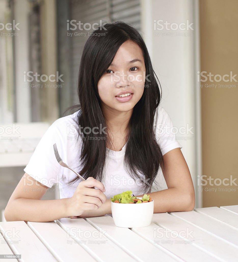 lady eat vegetable salad on the restaurant royalty-free stock photo