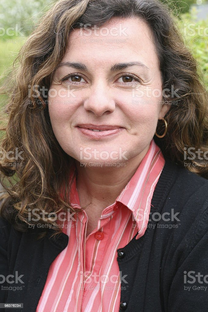 Lady, forty years old, looking into the camera royalty-free stock photo