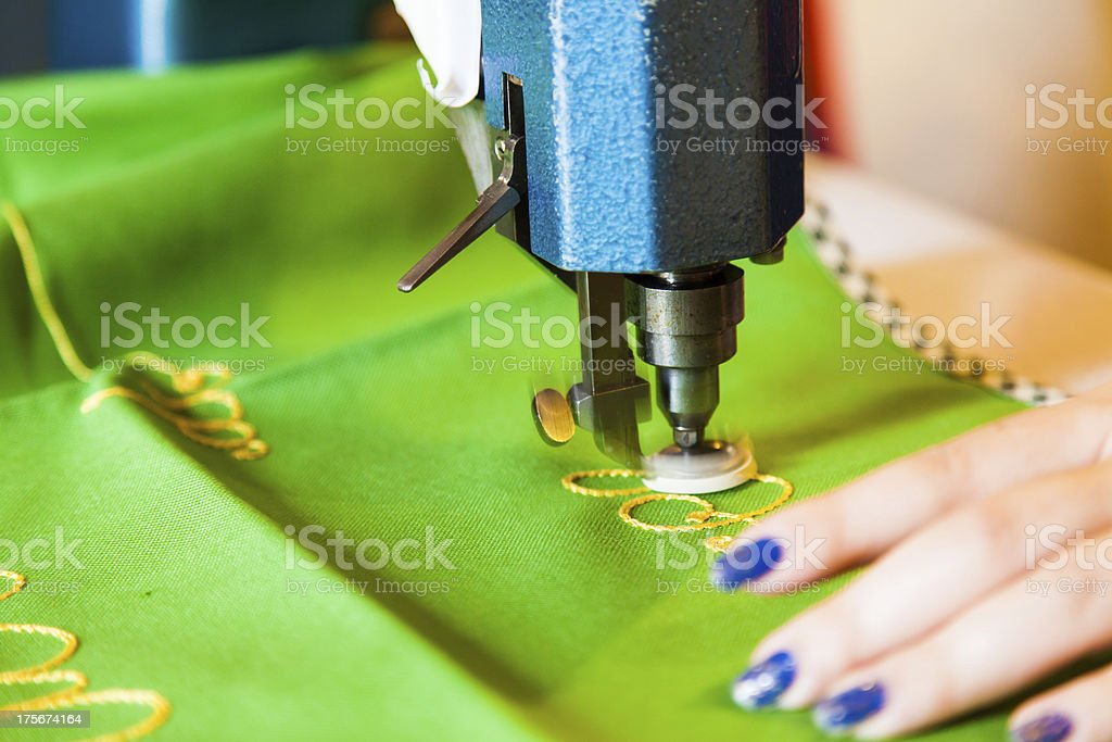 Lady hand at sewing royalty-free stock photo