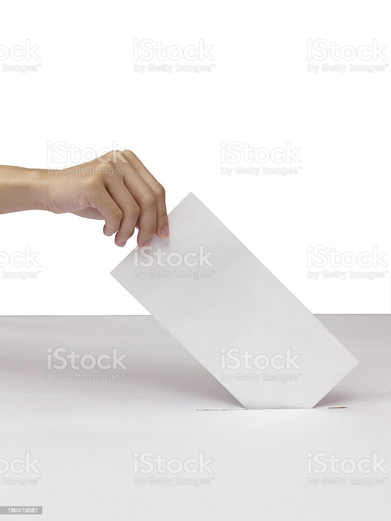 Lady hand putting a voting ballot in slot of white royalty-free stock photo