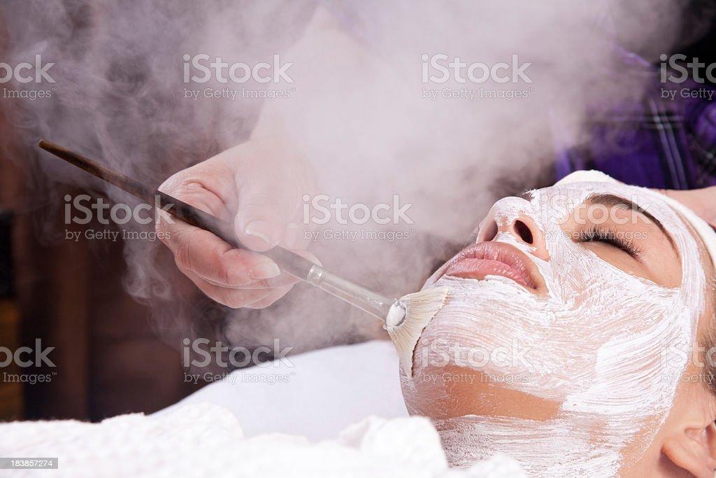 Lady having a facial spa treatment stock photo
