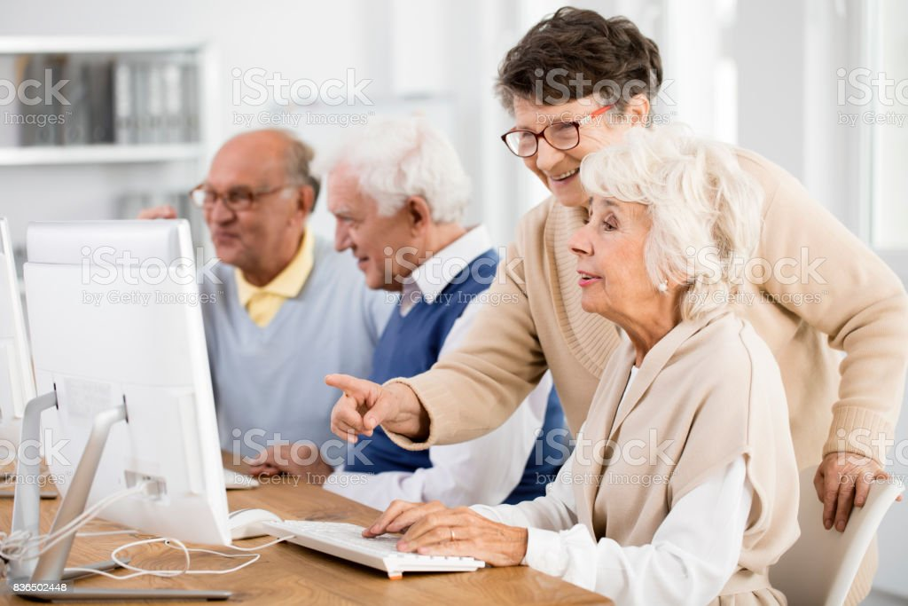 Lady helping her friend stock photo