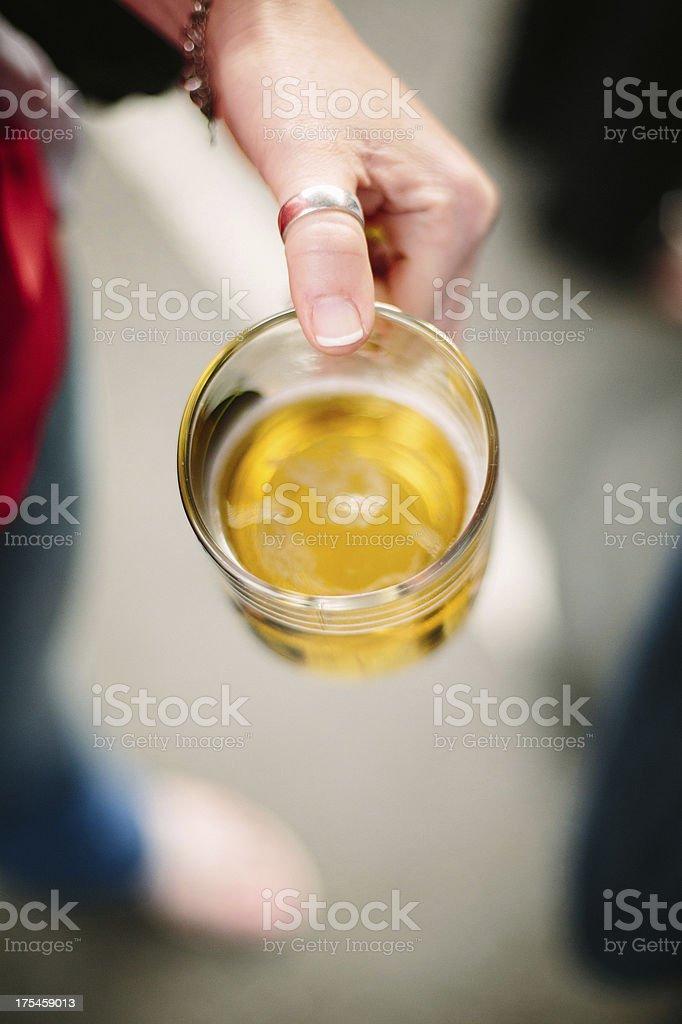 Lady holding a beer mug stock photo