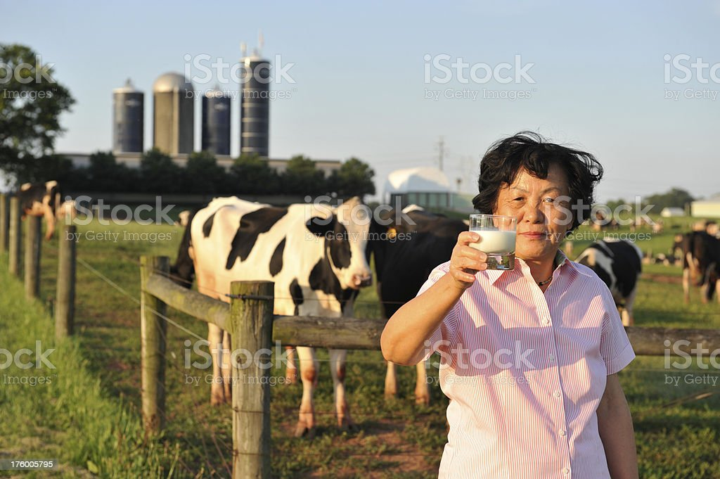 Lady Holding Glass of Milk royalty-free stock photo
