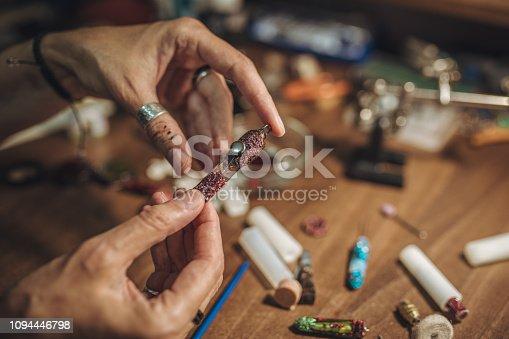 istock Lady holding handmade jewelry 1094446798