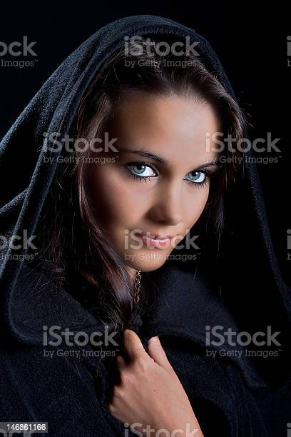 Lady In A Black Cape Stock Photo - Download Image Now