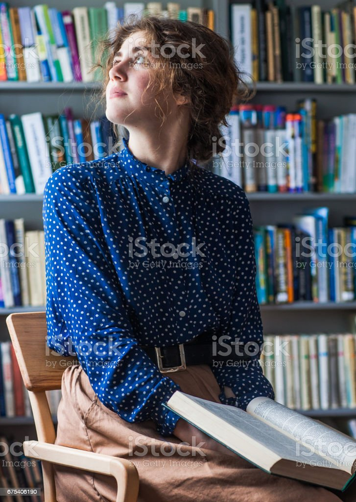 Lady in a library royalty-free stock photo