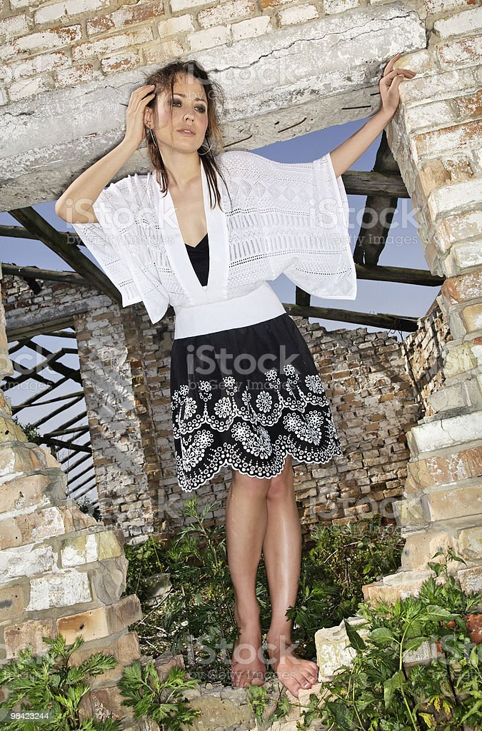 Lady in a ruined fenestra royalty-free stock photo