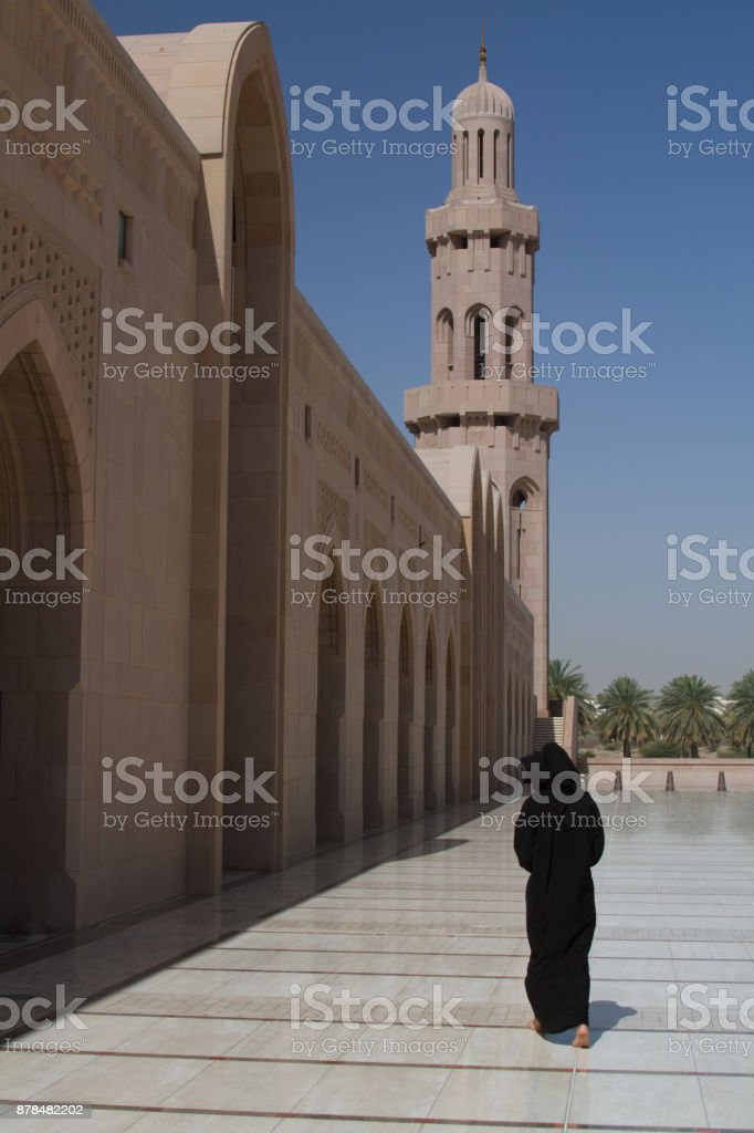 Lady in abaya at Sultan Quaboos Mosque. stock photo