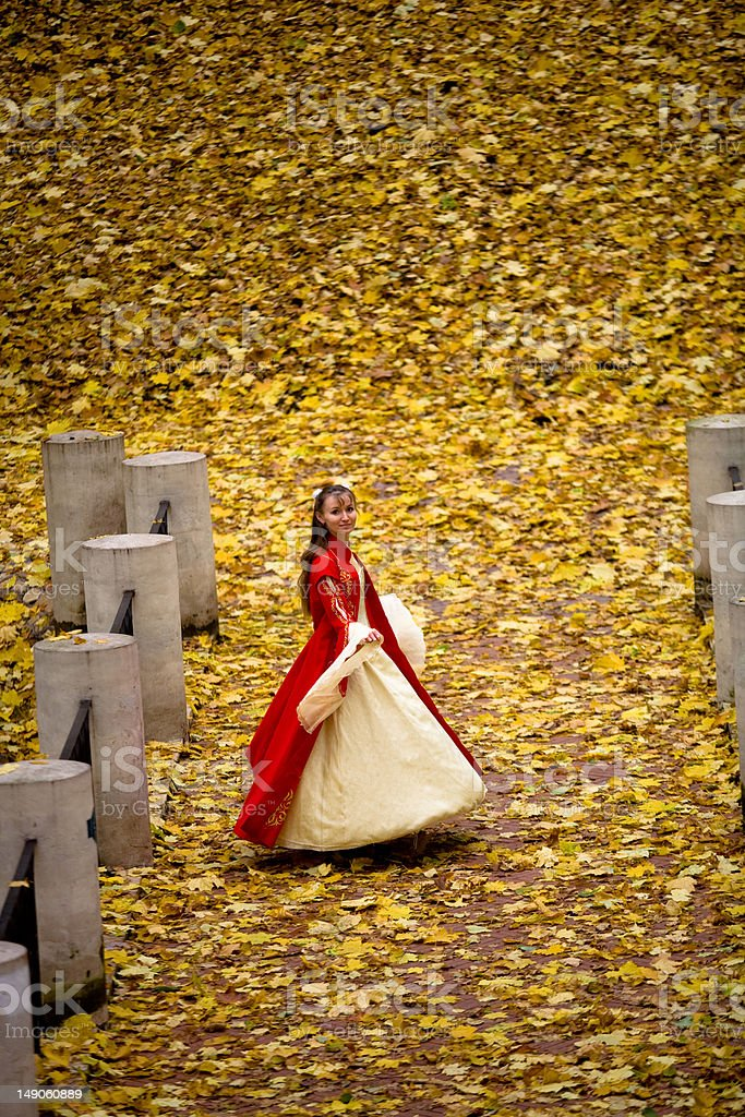 Lady in autumn forest royalty-free stock photo