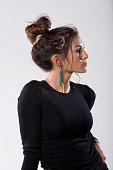 beautiful woman in black profile messy bun