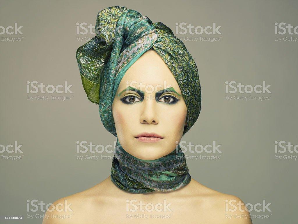 Lady in green turban stock photo
