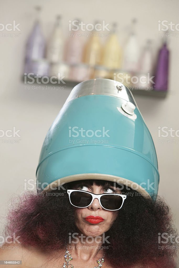 Lady in Large Hair Dryer royalty-free stock photo