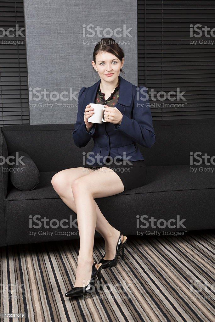 Lady in office holding mug royalty-free stock photo