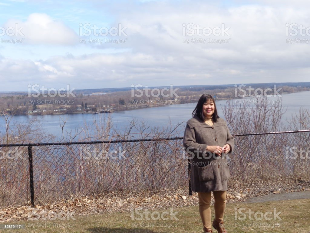 Lady in Park above Lake stock photo