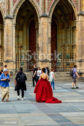 istock Lady in Red Dress - Prague 1184449497