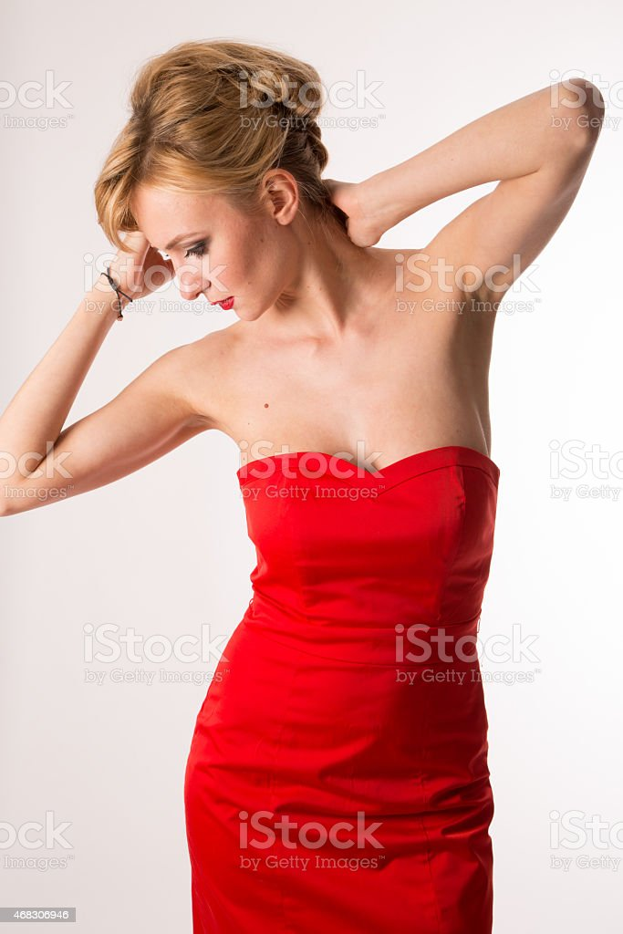 Lady in red posing for fashio stock photo