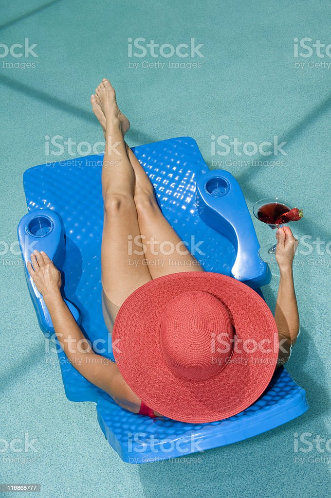 Lady in Red Swim Suite Floating at Swimming Pool royalty-free stock photo