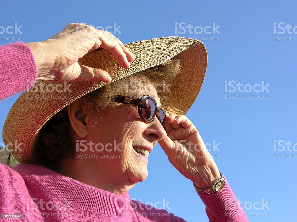 Lady in Sunhat and Sunglasses stock photo