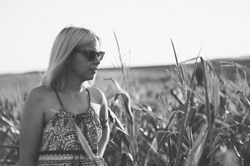 523172398 istock photo Lady in the corn field. Black and white. 923078648