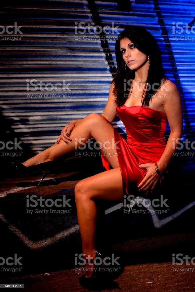 Lady in the red dress sitting royalty-free stock photo