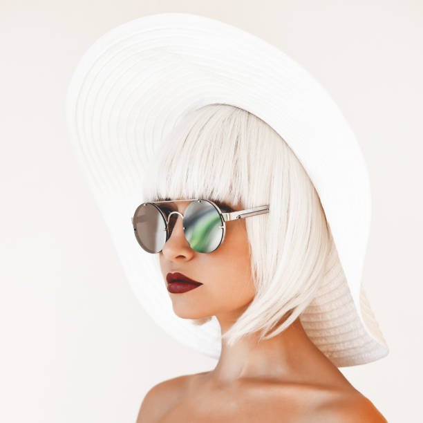 Lady in white hat and mirror sunglasses stock photo