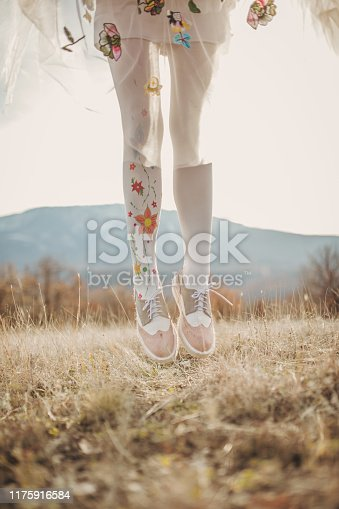 One woman in white stockings on a meadow, part of.