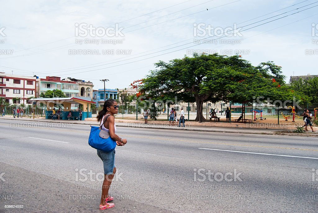 Lady is about to cross the street, Vedado, Havana, Cuba stock photo