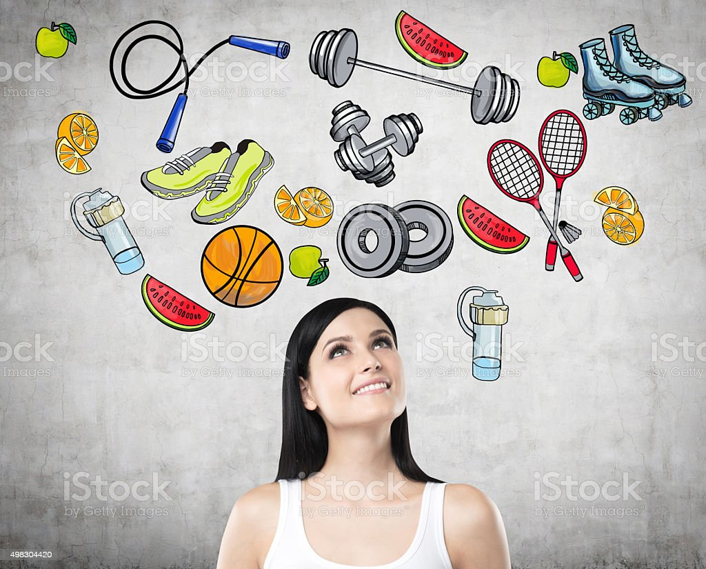 lady is thinking about her choice of sport activity. stock photo