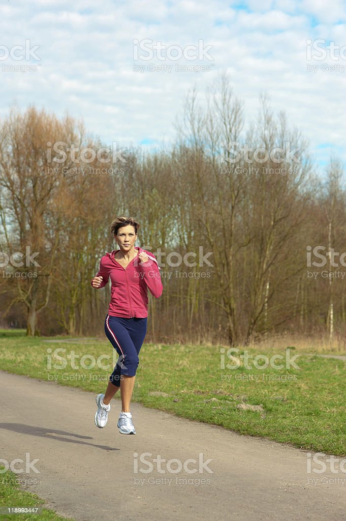 Lady Jogging in a Park royalty-free stock photo
