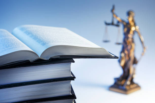 Lady Justice And An Open Law Book stock photo