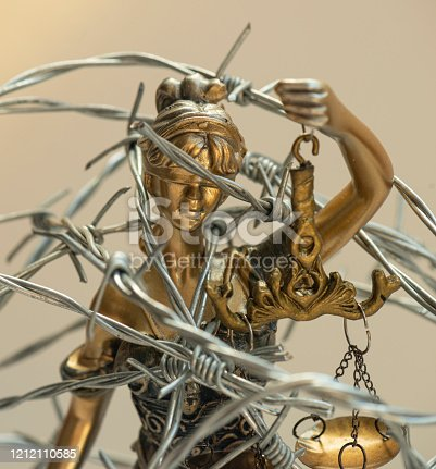 824305956 istock photo Lady Justice and Barbed Wire 1212110585