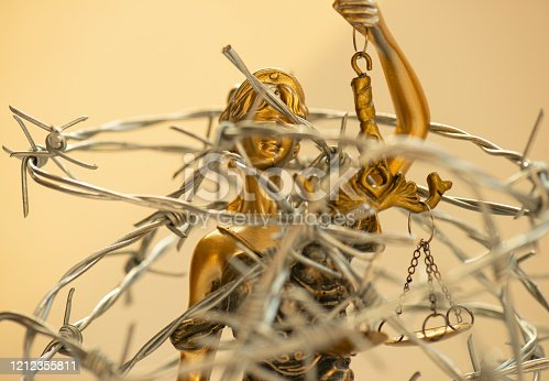 824305956 istock photo Lady Justice and Barbed Wire 1212355811