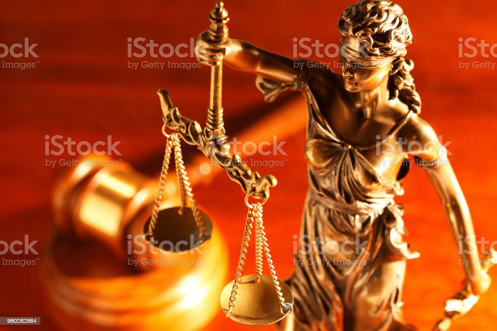 Lady Justice And Gavel On Desk stock photo