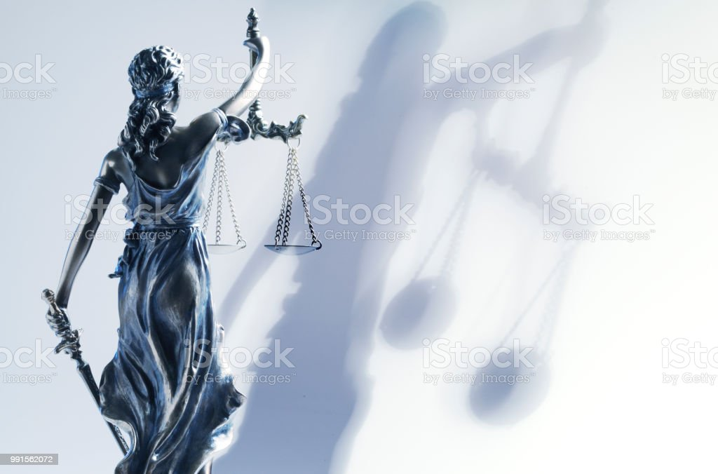 Lady Justice And Her Shadow stock photo