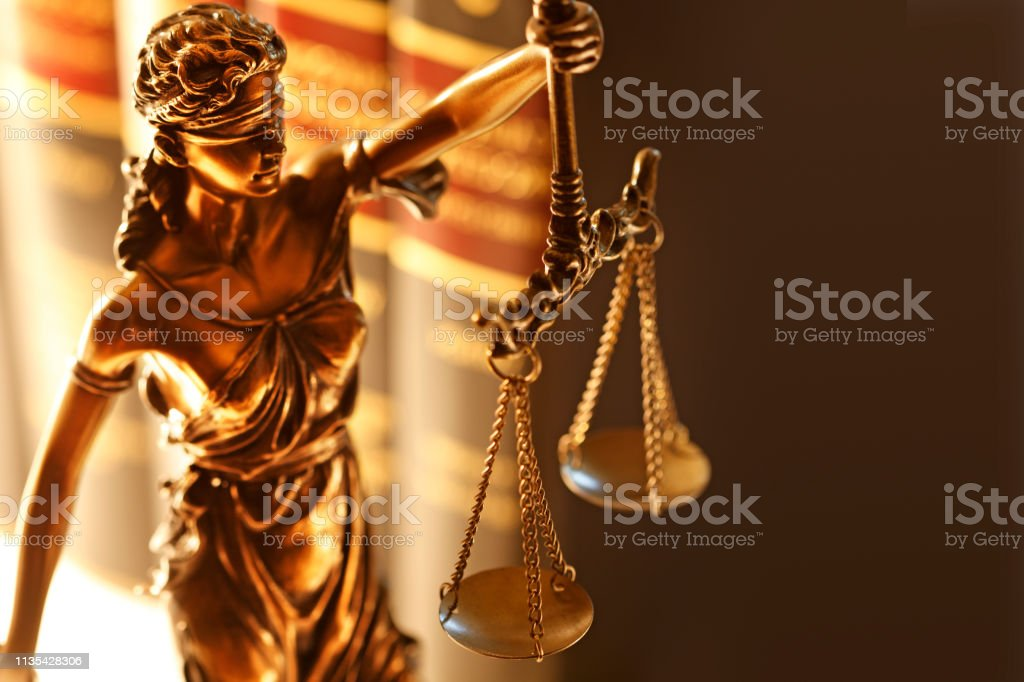 Lady Justice And Row Of Law Books stock photo