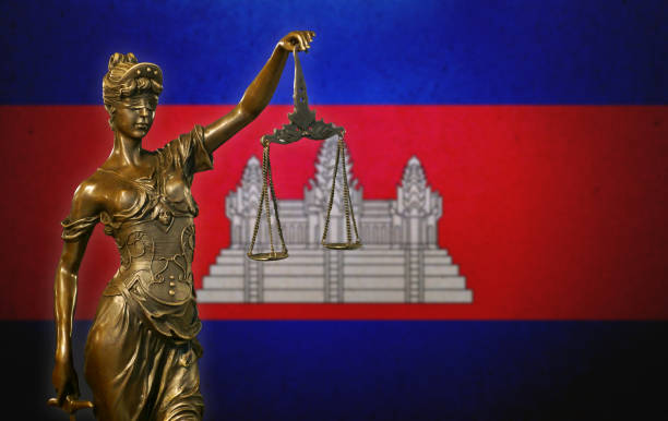 Lady Justice before a Cambodian flag stock photo