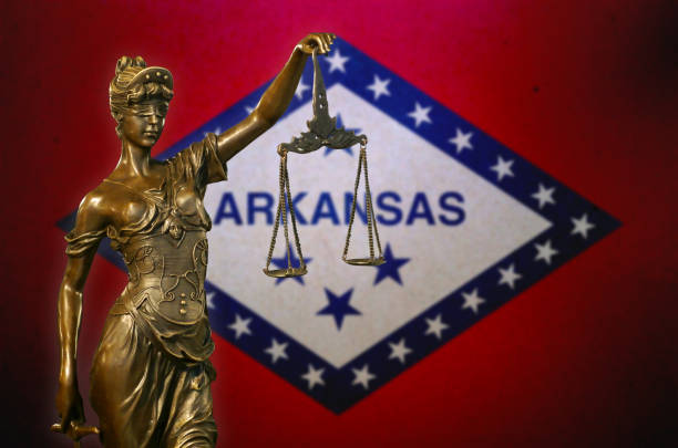 Lady Justice before a flag of Arkansas stock photo
