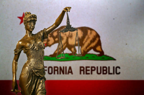 Lady Justice before a flag of California stock photo